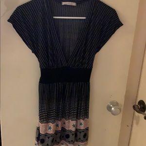 Black mini dress with low v neck